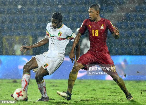 Malis midfielder Cheick Oumar Doucoure vies for the ball with Ghanas midfielder Mohammed Iddriss during the FIFA U17 World Cup quarterfinal match...