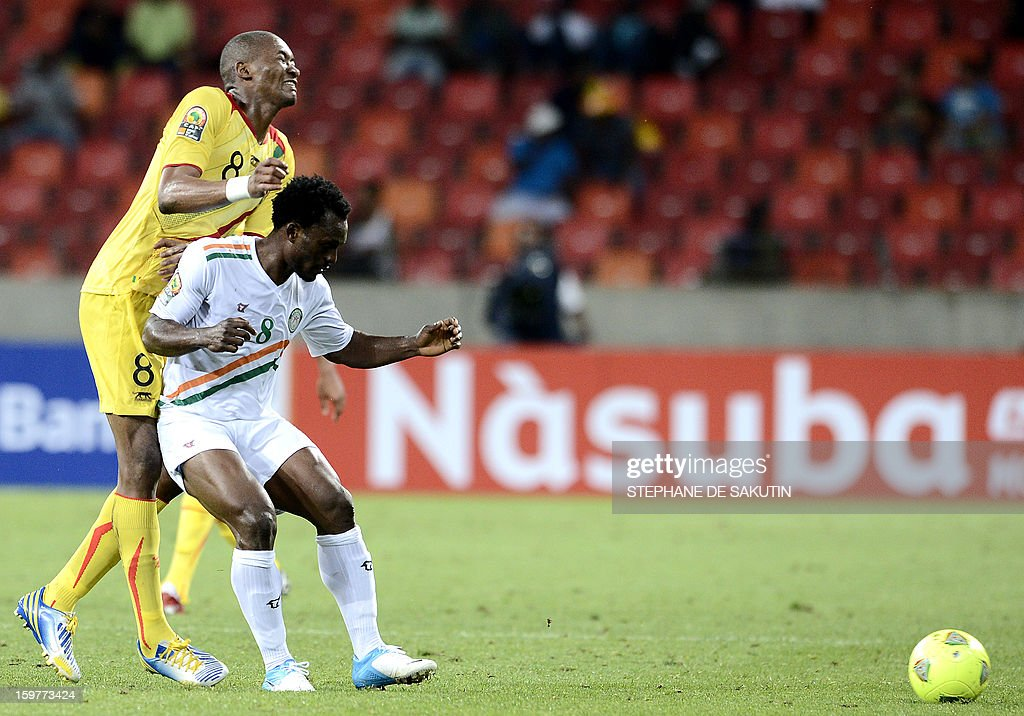 Mali's midfielder Kalilou Traore (L) fights for the ball with Niger's defender Kourouma Fatokouma during the 2013 Africa Cup of Nations football match at Nelson Mandela Bay Stadium in Port Elizabeth on January 20, 2013.
