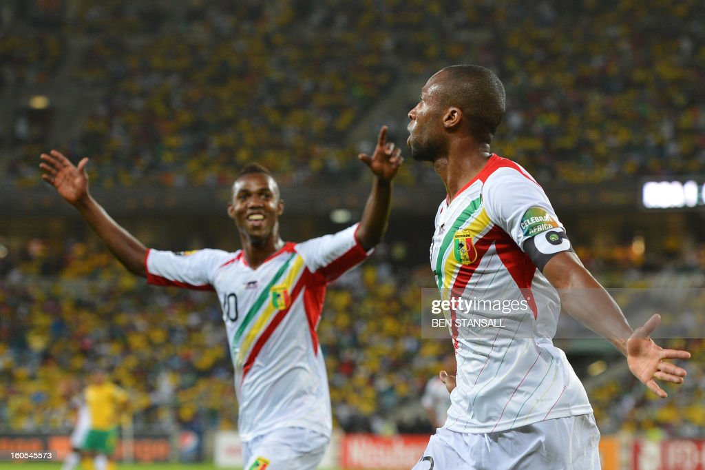 Mali's midfielder Seydou Keita (R) celebrates after scoring a goal during the African Cup of Nation 2013 quarter final football match South-Africa vs Mali, on February 2, 2013 in Durban.