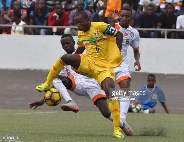 Mali's Mohamed Camara vies with Boubacar Soumana at the Palais des sports in Abidjan as they take part in the 8th Jeux de la Francophonie Games on...
