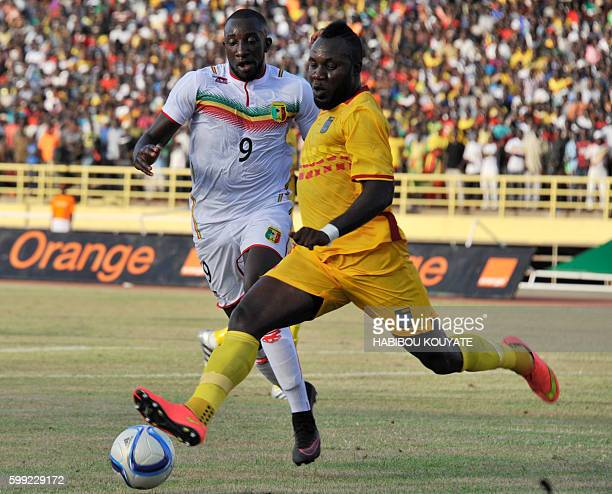 Mali's National football team player Moussa Marega fights for the ball with Benin's Salomon Junior in Bamako on September 4 2016 during their 2017...