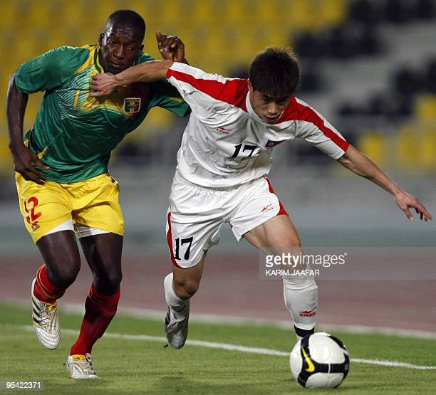 Mali's player Abdou Traore vies with North Korea's Yun Yong Il during their 9th International Friendship Tournament football match in Doha on...