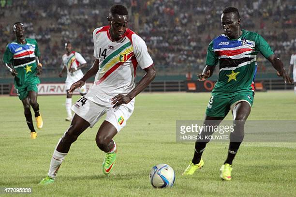 Mali's player Sambou Yttabare vies with South Sudan's player Friday Zico Paul on June 13 2015 in Bamako during their 2017 African Cup of Nations...