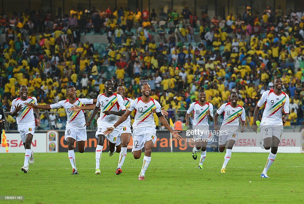 Mali's players celebrate at the end of the penalty shootout of the African Cup of Nation 2013 quarter final football match South-Africa vs Mali, on February 2, 2013 in Durban. Mali won 3-1 on penalties.