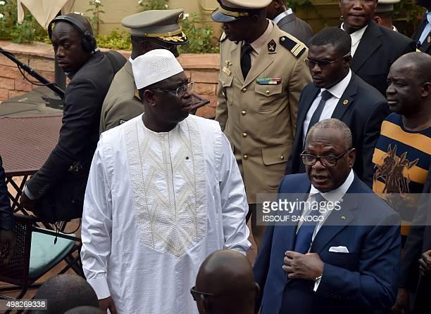 Mali's president Ibrahim Boubacar Keita and Senegal's president Macky Sall visit the Radisson Blu hotel in Bamako on November 22 2015 two days after...