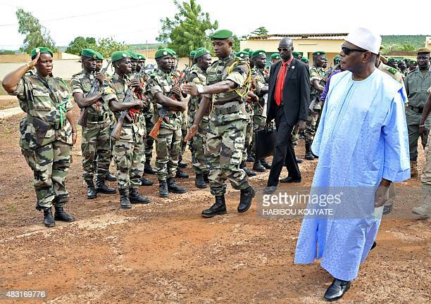 Mali's President Ibrahim Boubacar Keita reviews troops in Kati near Bamako on August 6 after visting soldiers injured in an attack on their camp in...