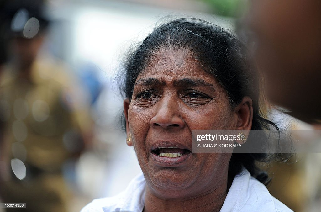 Malkanthi Edirisinghe, the wife of a Sri Lankan inmate killed during a prison riot weeps outside the police morgue after an autopsy in Colombo on November 11, 2012. Sri Lanka's main opposition party demanded an independent inquiry into a prison riot that left 27 convicts dead, alleging many were shot by security forces in a cold-blooded 'massacre'. The United National Party (UNP) called for a parliamentary investigation into the riot that erupted on November 9 at the maximum-security Welikada prison in the capital Colombo. AFP PHOTO/ IsharaS