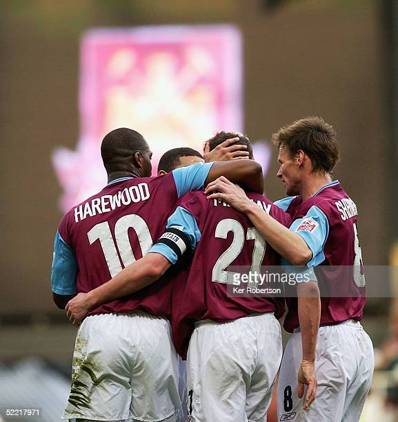 Malky Mackay celebrates scoring the third goal with his West Ham United team mates during the CocaCola Championship match between West Ham United and...