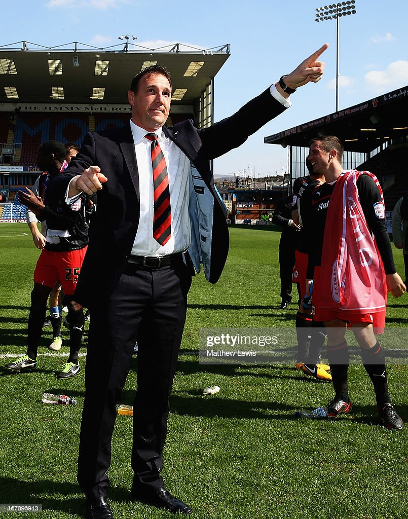 Malky MacKay, manager of Cardiff City celebrates going up to the Premiership after the npower Championship match between Burnley and Cardiff City at Turf Moor on April 20, 2013 in Burnley, England.