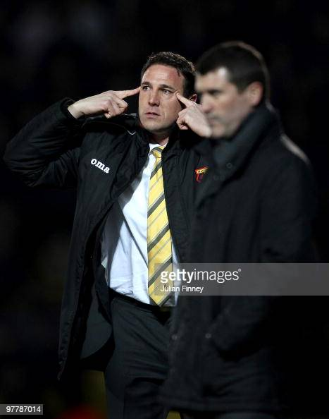 Malky Mackay manager of Watford gives a signal as Roy Keane manager of Ipswich looks on during the CocaCola Championship match between Watford and...