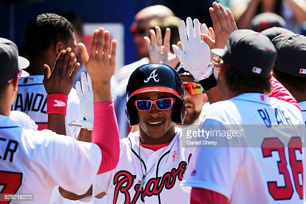 Mallex Smith of the Atlanta Braves celebrates scoring in the eight inning against the Arizona Diamondbacks at Turner Field on May 8 2016 in Atlanta...
