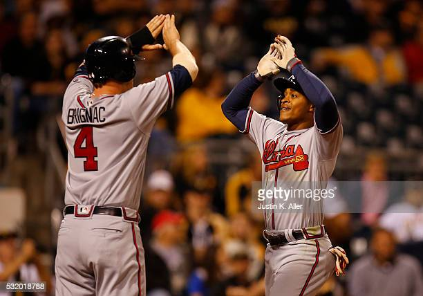 Mallex Smith of the Atlanta Braves celebrates with Reid Brignac after hitting a two run home run in the seventh inning during the game against the...
