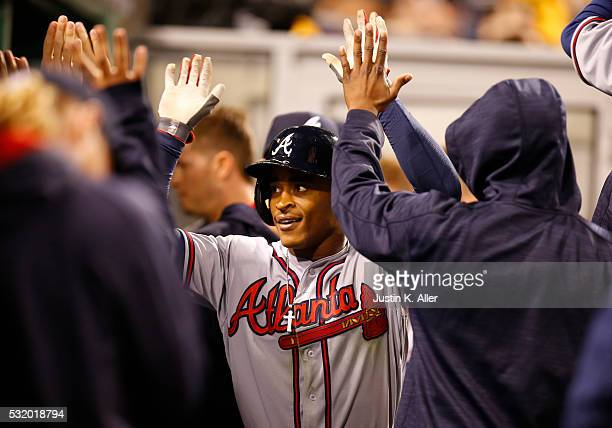 Mallex Smith of the Atlanta Braves celebrates with teammates after hitting a two run home run in the seventh inning during the game against the...