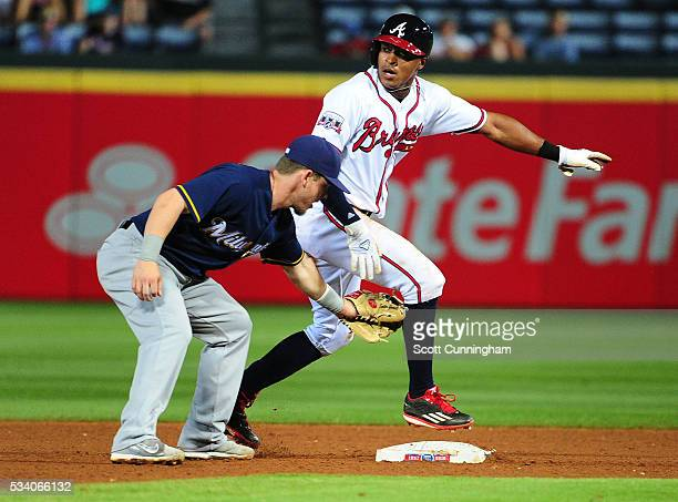 Mallex Smith of the Atlanta Braves is called out on a steal attempt in the seventh inning after overrunning second base by Scooter Gennett of the...