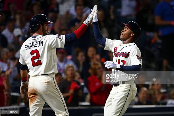 Mallex Smith of the Atlanta Braves is congratulated by Dansby Swanson after they both scored in the seventh inning at Turner Field on October 1 2016...
