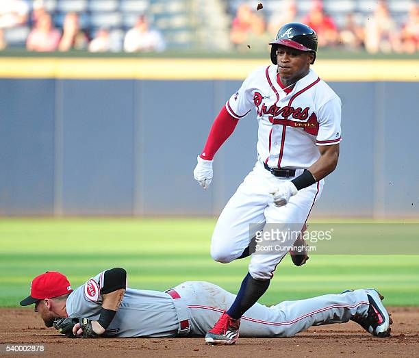 Mallex Smith of the Atlanta Braves rounds second base during the first inning against Zack Cozart of the Cincinnati Reds at Turner Field on June 13...