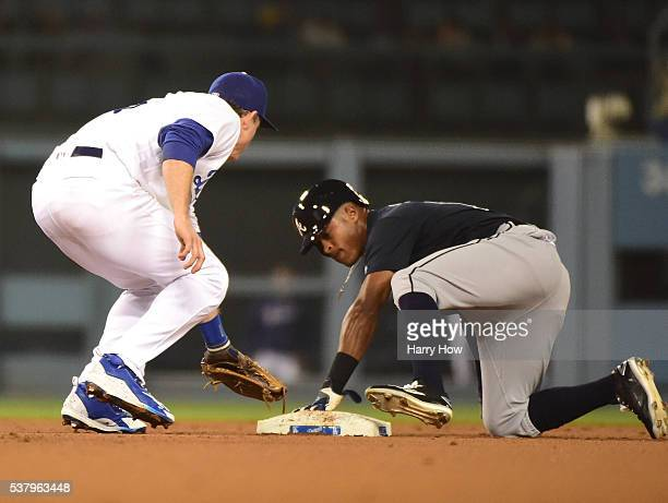 Mallex Smith of the Atlanta Braves steals second base in front of Chase Utley of the Los Angeles Dodgers during the fifth inning at Dodger Stadium on...