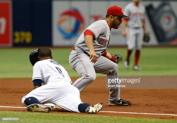 Mallex Smith of the Tampa Bay Rays beats third baseman Eugenio Suarez of the Cincinnati Reds to third base as he advances on the RBI single by Steven...