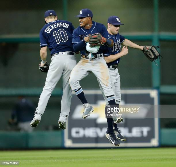 Mallex Smith of the Tampa Bay Rays celebrates with Corey Dickerson and Peter Bourjos after the final out against the Houston Astros at Minute Maid...