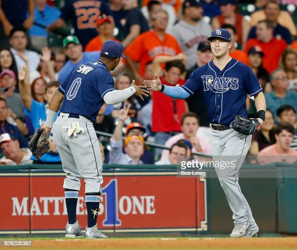 Mallex Smith of the Tampa Bay Rays congratulates Corey Dickerson after he made a running catch on a line drive by Yuli Gurriel of the Houston Astros...