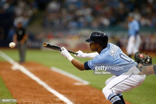Mallex Smith of the Tampa Bay Rays hits a bunt single to the catcher during the third inning of a game against the New York Yankees on April 2 2017...