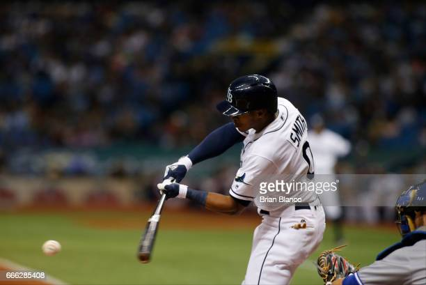 Mallex Smith of the Tampa Bay Rays hits an infield single to second base during the third inning of a game against the Toronto Blue Jays on April 8...