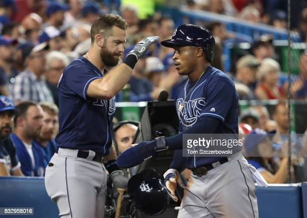 Mallex Smith of the Tampa Bay Rays is congratulated by Evan Longoria after scoring a run in the fifth inning during MLB game action against the...