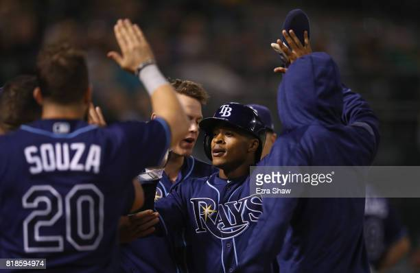 Mallex Smith of the Tampa Bay Rays is congratulated by teammates after he scored the tying run in the ninth inning against the Oakland Athletics at...