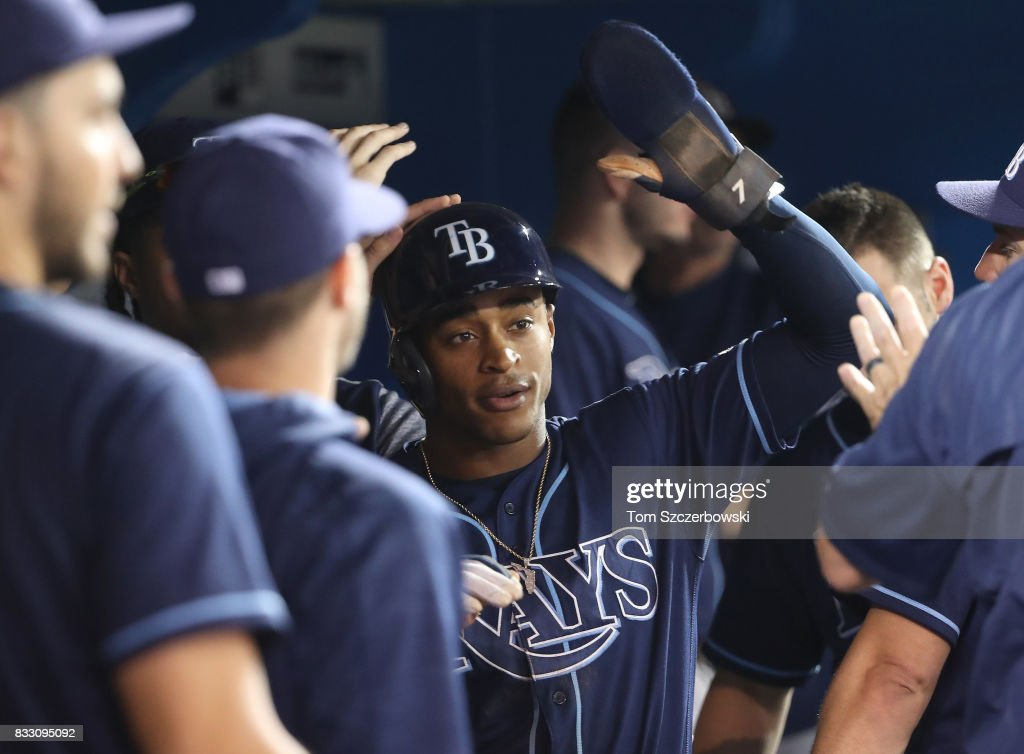 Mallex Smith #0 of the Tampa Bay Rays is congratulated by teammates in the dugout after scoring a run on a bases-loaded walk in the seventh inning during MLB game action against the Toronto Blue Jays at Rogers Centre on August 16, 2017 in Toronto, Canada.