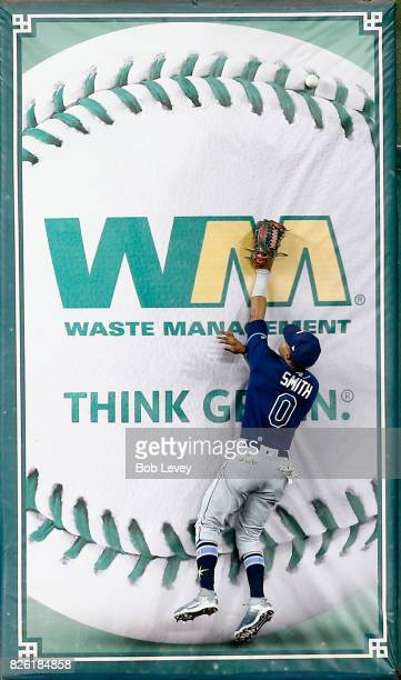 Mallex Smith of the Tampa Bay Rays leaps at the wall but is unable to catch a fly ball by Yuli Gurriel of the Houston Astros in the first inning at...