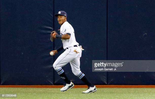 Mallex Smith of the Tampa Bay Rays prepares to throw a fly ball back to the infield during the game against the Boston Red Sox at Tropicana Field on...