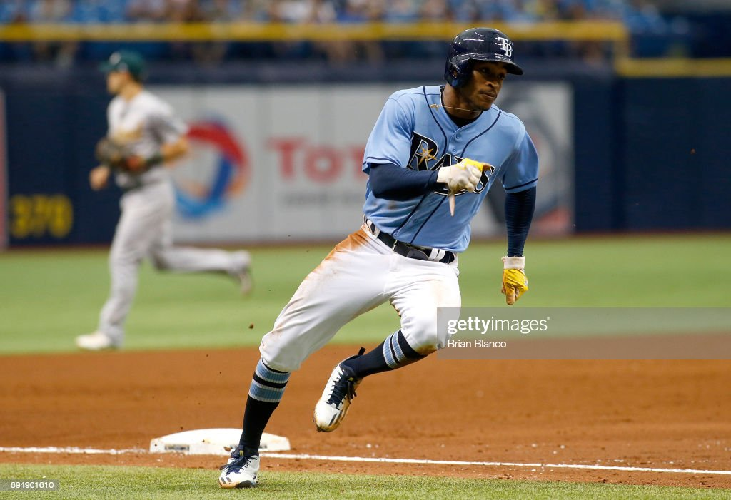 Mallex Smith #0 of the Tampa Bay Rays rounds third base as he sprints home to score off of an RBI double by Corey Dickerson during the fifth inning of a game against the Oakland Athletics on June 11, 2017 at Tropicana Field in St. Petersburg, Florida.