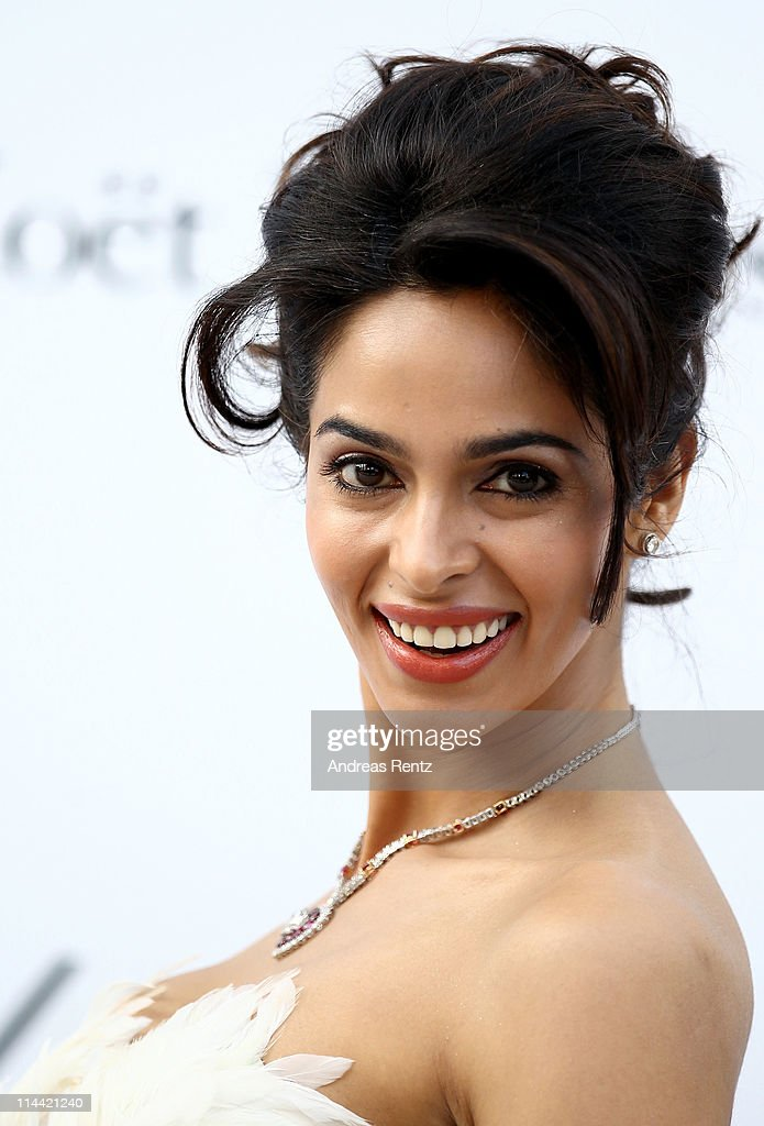 Mallika Sherawat attends amfAR's Cinema Against AIDS Gala during the 64th Annual Cannes Film Festival at Hotel Du Cap on May 19, 2011 in Antibes, France.