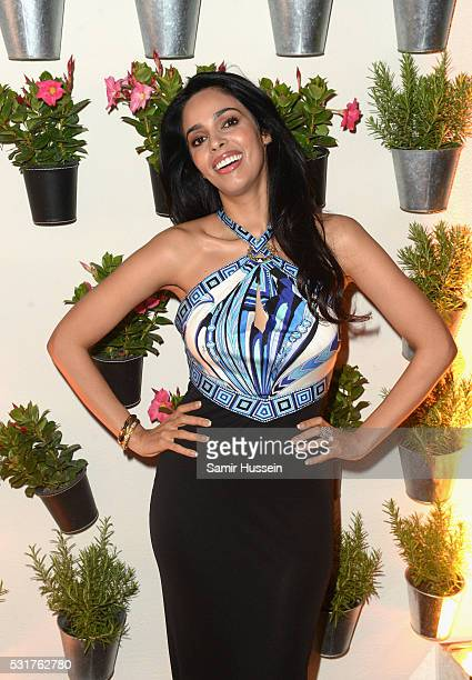 Mallika Sherawat attends The Harmonist Cocktail Party during the 69th annual Cannes Film Festival at the Plage du Grand Hyatt on May 16 2016 in...
