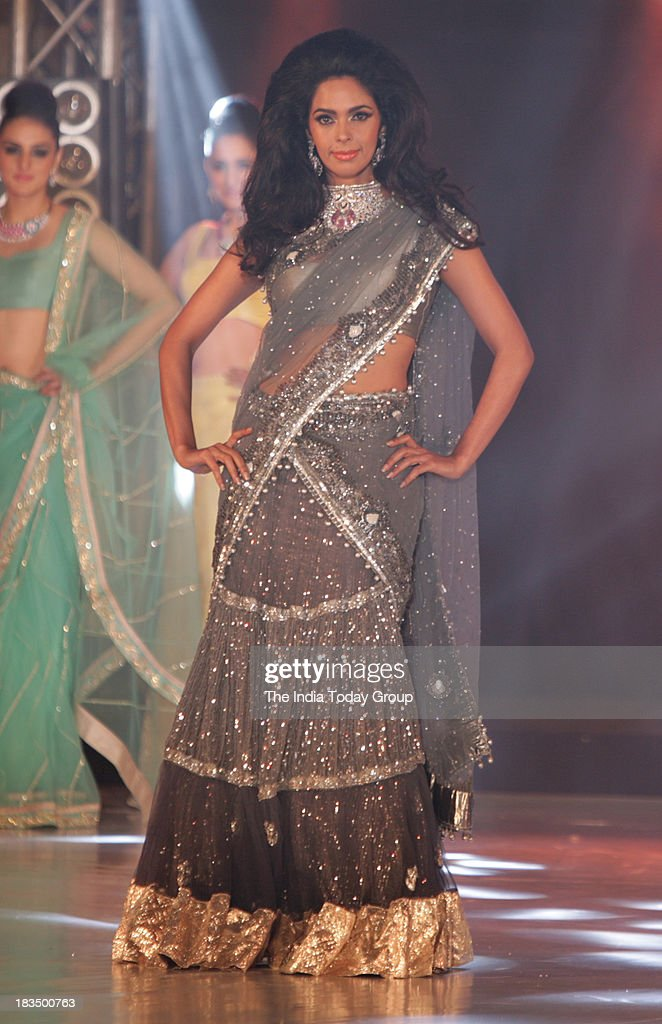 Mallika Sherawat walks the ramp during a fashion show organised by India International Bullion Summit showcasing exquisite jewellery.