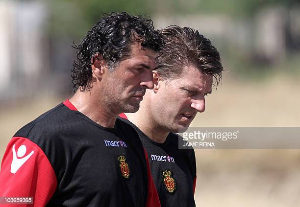 Mallorca's Danish coach Michael Laudrup walks with Miguel Angel Nadal uncle of Rafael Nadal and member of Mallorca's technical staff during the first...