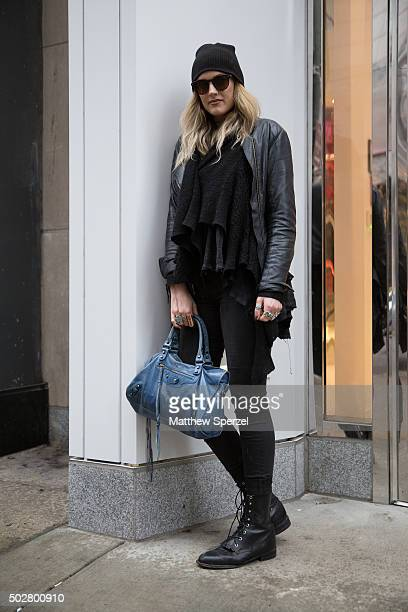 Mallory Antonino is seen on Michigan Avenue wearing a black cotton Free People shirt black wool All Saints sweater black HM jeans black leather...