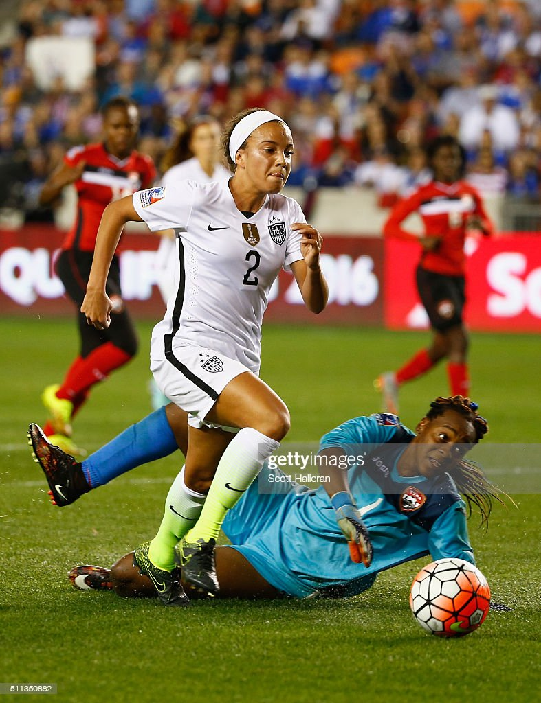 Mallory Pugh #2 of the United States battles for the ball with keeper Kimika Forbes #1 of Trinidad and Tobago during their Semifinal of the 2016 CONCACAF Women's Olympic Qualifying at BBVA Compass Stadium on February 19, 2016 in Houston, Texas.