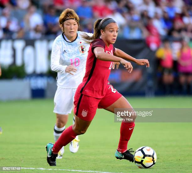 Mallory Pugh of the United States dribbles away from Mizuho Sakaguchi of Japan during the first half of the 2017 Tournament Of Nations at StubHub...