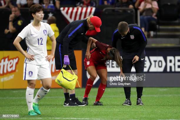 Mallory Pugh of the USA is helped off the field during the game against the Korea Republic at the MercedesBenz Superdome on October 19 2017 in New...