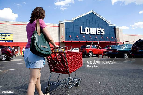 Mallory Shure pushes a cart in the parking lot outside a Lowe's store in the Brooklyn borough of New York US on Saturday Aug 16 2008 Lowe's Cos the...