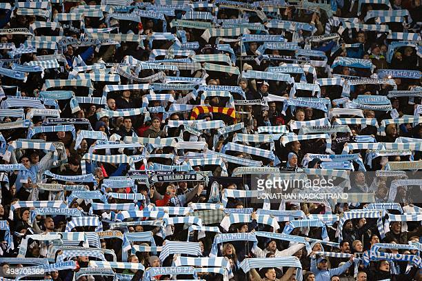 Malmo fans wave their scarves prior to during the UEFA Champions League Group A secondleg football match Malmo FF vs Paris SaintGermain in Malmo...