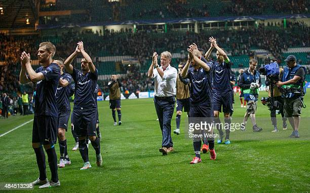 Malmo FF manager Age Hareide and his players applaud at the end of the UEFA Champions League Qualifying Round Play off First Leg match between Celtic...