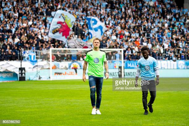 Malmo FF presents the player Johan Dahlin and Kingsley Sarfo during the Allsvenskan match between Malmo FF and Athletic FC Eskilstuna at Swedbank...