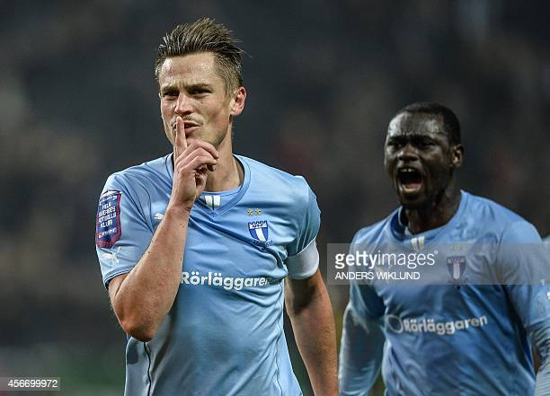 Malmo's Markus Rosenberg celebrates after scoring a goal during the Swedish football league match between AIK and Malmo at the Friends Arena in Solna...
