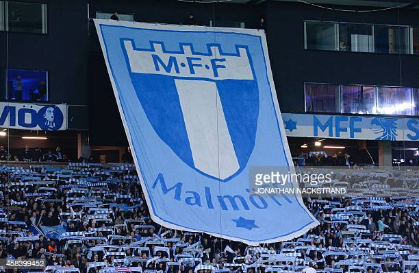 Malmo's supporters cheer their team prior to the UEFA Champions League Group A football match Malmo FF vs Club Atletico de Madrid in Malmo Sweden on...