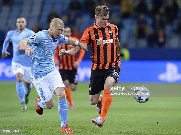 Malmo's Swedish defender Anton Tinnerholm and Shakhtar Donetsk's forward Olexander Gladkiy vie for the ball during the UEFA Champions League Group A...