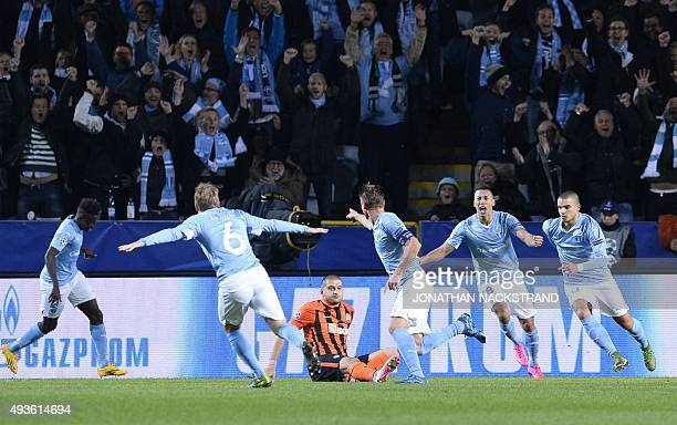 Malmo's Swedish forward Markus Rosenberg celebrates with his teammates after scoring the opening goal during the UEFA Champions League Group A...