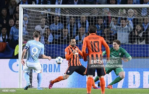 Malmo's Swedish forward Markus Rosenberg shoots to score past Shakhtar Donetsk's Ukrainian goalkeeper Andriy Pyatov during the UEFA Champions League...