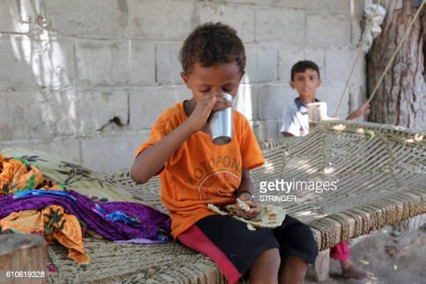 A malnourished Yemeni boy sits on a wooden bench on September 26 2016 in an impoverished coastal village on the outskirts of the rebelheld Yemeni...